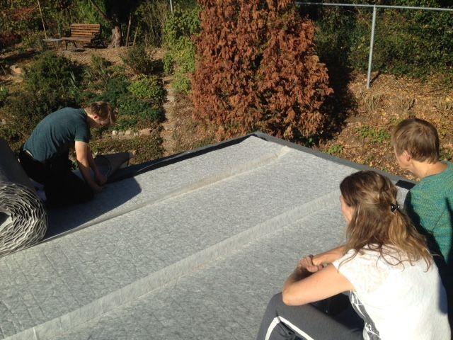 De eerste laag op het dak